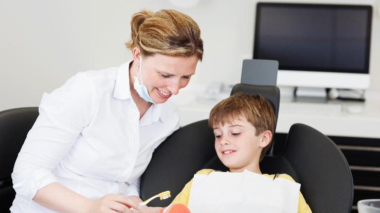 child with dentist in office | infant oral health | Pediatric Dentistry in Palos Heights IL