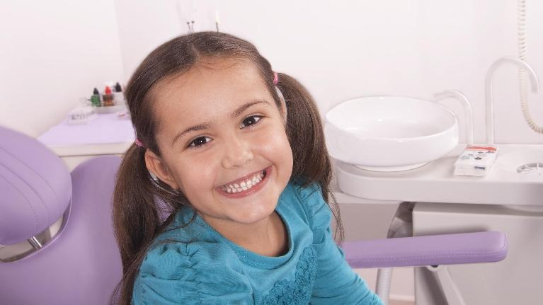 smiling girl in dental chair | kids' dentist in Palos Heights IL