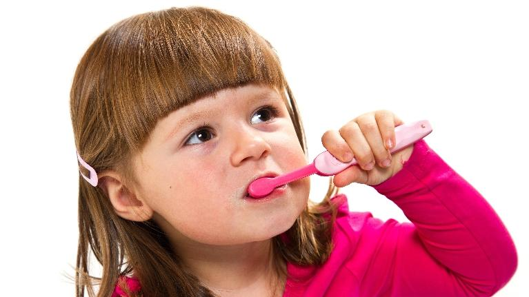 toddler brushing her teeth | pediatric dentist palos heights | kids dentist palos heights