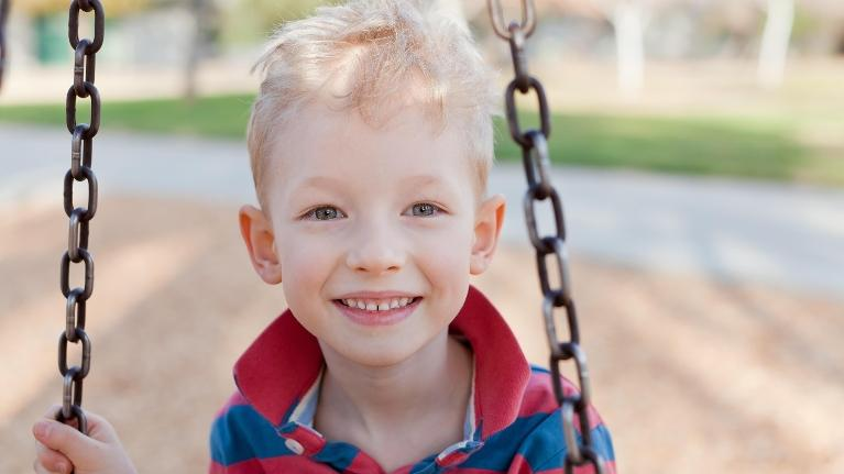 smile little boy on a swing | Children's Dentistry in Palos Heights, IL