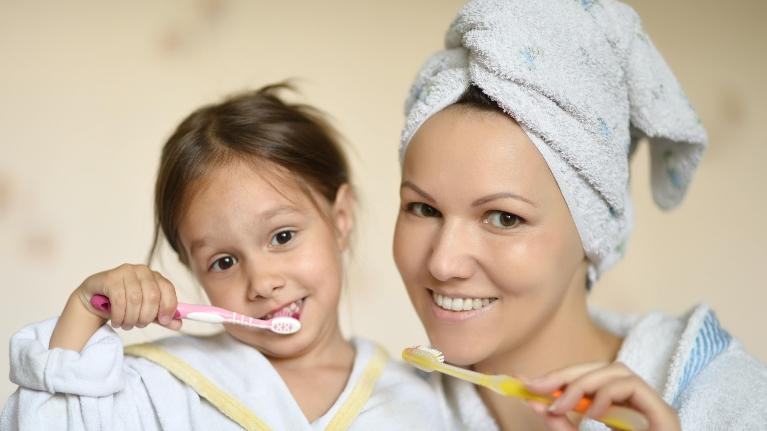 child's first visit | mother and daughter brushing teeth
