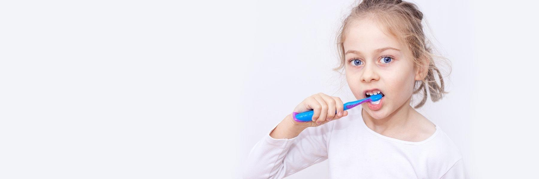 Girl brushing teeth | children's restorative dentistry Palos Heights P